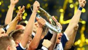 Melbourne Victory hold the Hyundai A-League Championship trophy aloft after last season's Grand Final win.