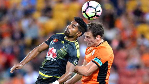 Wellington's Roy Krishna wins the aerial battle with Roar's Luke DeVere.