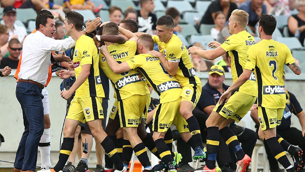 Central Coast Mariners players celebrate Kwabena Appiah's goal in their win over Adelaide United.