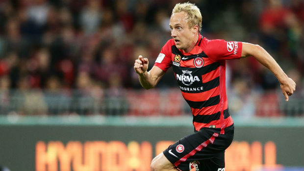 Wanderers midfielder Mitch Nichols charges onto the ball at Spotless Stadium.