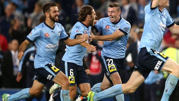 Josh Brillante (centre) celebrates with teammates following Sydney FC's Grand Final win over Victory.