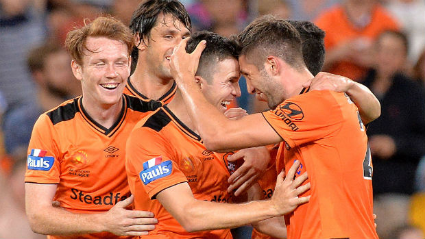 Brandon Borrello celebrates scoring against Adelaide in Round 4 with teammates.
