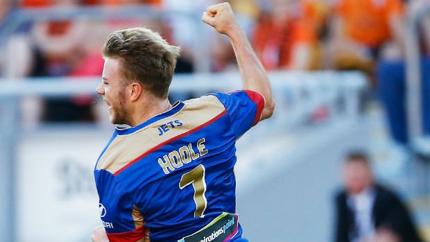 Jets winger Andrew Hoole celebrates scoring against Brisbane at Suncorp Stadium.