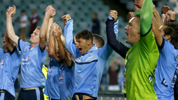 Sydney FC players celebrate their win over Melbourne Victory in Friday night's Big Blue.