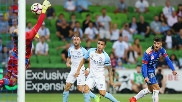 City striker Tim Cahill opens the scoring against the Jets with a header on Saturday night.
