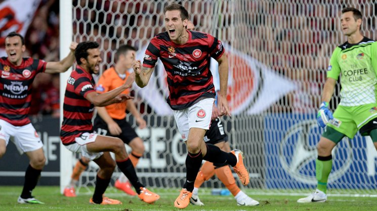 Matthew Spiranovic celebrates giving the Wanderers the lead in the 2014 Hyundai A-League grand final.