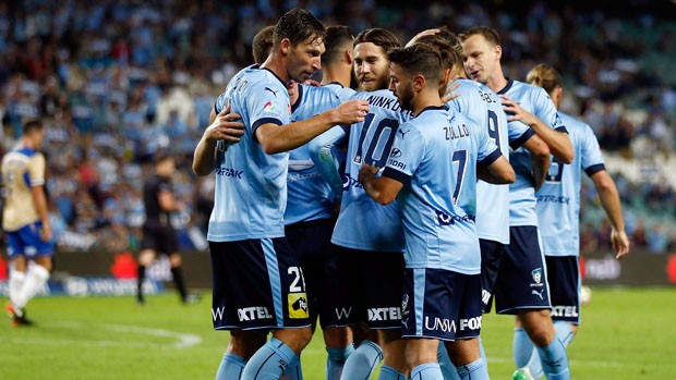 Sydney FC players celebrate a goal in their Round 27 win over Newcastle Jets.
