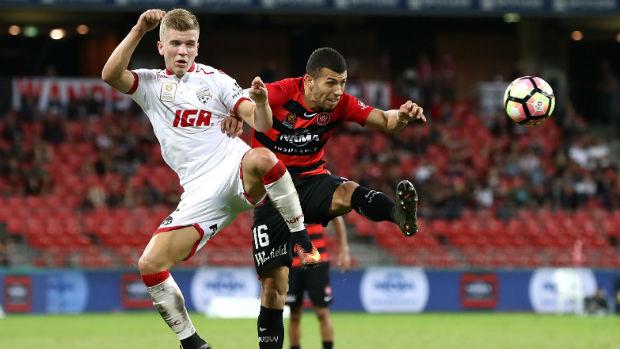 Riley McGree challenges Jaushua Sotirio for the ball at Spotless Stadium.