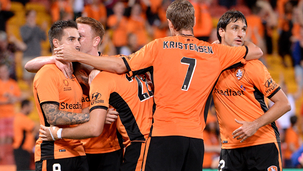 Roar players celebrate after Jamie Maclaren equalised early in the second half.