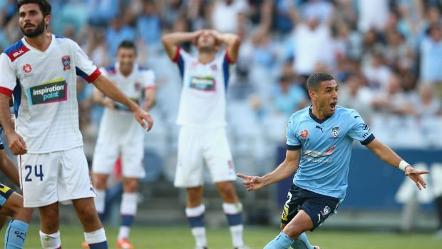 Sydney FC defender Ali Abbas celebrates scoring against the Jets in his comeback match.