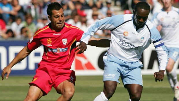 Adelaide United's inaugural captain Ross Aloisi and former Sydney FC striker Dwight Yorke.