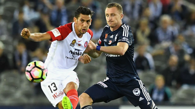 Wanderers' Bruno Pinatares clears the ball from Victory's Besart Berisha.