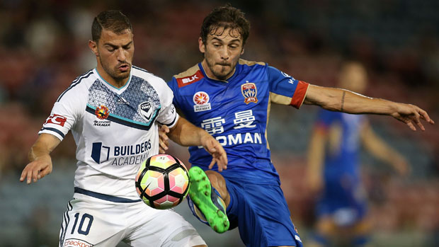 Victory playmaker James Troisi and the Jets' Mateo Poljak battle for possession at McDonald Jones Stadium.