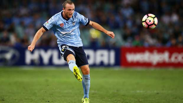 Sydney defender Rhyan Grant gets a cross in during the clash with Melbourne City on Saturday night.