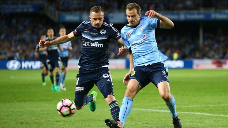 Melbourne Victory's Besart Berisha and Sydney FC defender Alex Wilkinson battle for the ball in last season's Hyundai A-League grand final.