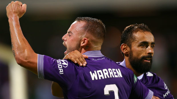 Perth Glory's Marc Warren and Diego Castro celebrate scoring against Melbourne Victory.