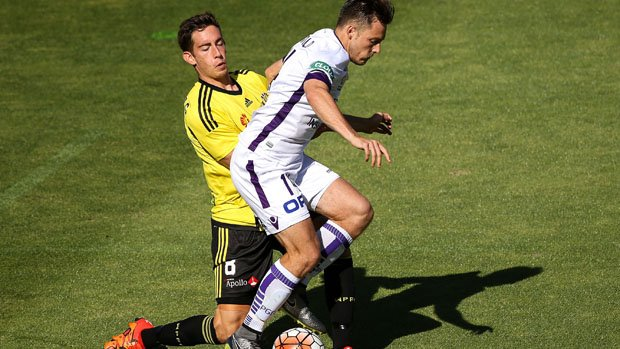 Glory striker Chris Harold holds off Phoenix midfielder Alex Rodriguez.