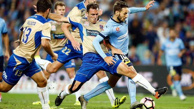 Jets midfielder Ben Kantarovski puts in a wonderful tackle to stop Sydney FC playmaker Milos Ninkovic in his tracks.