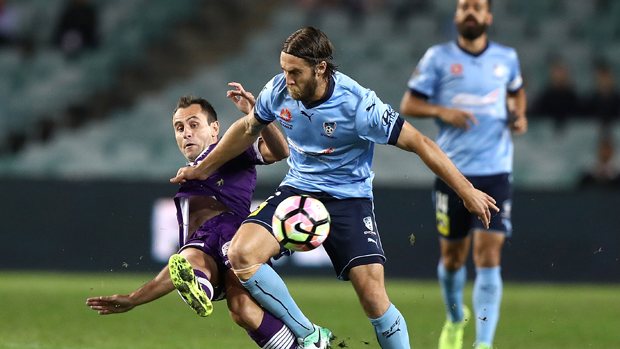 Sydney FC's Josh Brillante tangles with Perth Glory's Richard Garcia.