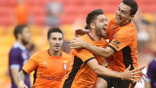Roar forward Brandon Borrello celebrates scoring against Perth Glory with Tommy Oar.