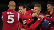 Adelaide United players celebrate Michael Marrone's goal in their Westfield FFA Cup win over Newcastle Jets