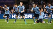 Sydney FC players celebrate after downing Melbourne Victory in the Hyundai A-League Grand Final.