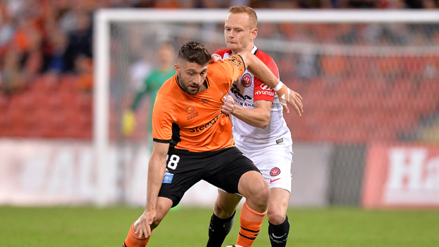 Roar attacker Brandon Borrello holds off Wanderers defender Jack Clisby.