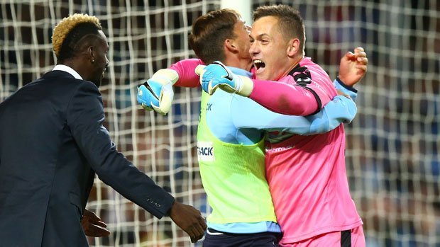 Danny Vukovic celebrates with teammates after Sydney FC's Grand Final win over Melbourne Victory.
