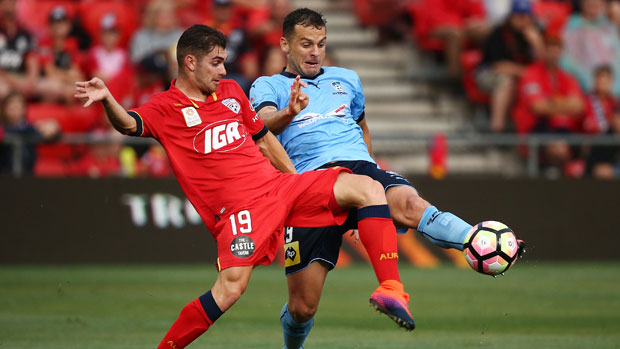 Adelaide's Ben Garuccio fights for the ball with Sydney FC striker Bobo.