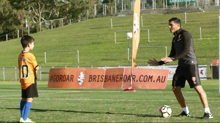 Yoshi with Brisbane Roar coach John Aloisi.