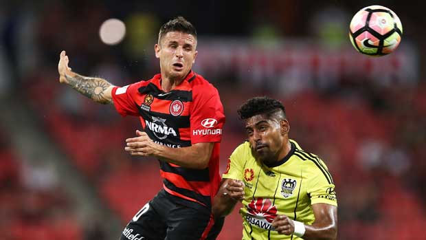 Wanderers playmaker Nico Martinez wins a header over Roy Krishna.