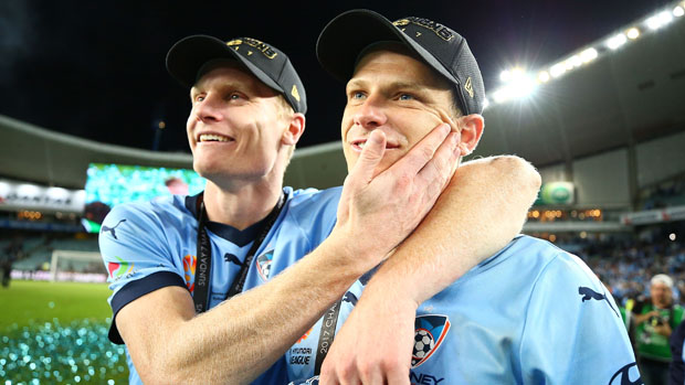 Alex Wilkinson and Matt Simon celebrate following Sydney FC's Grand Final triumph over Melbourne Victory.