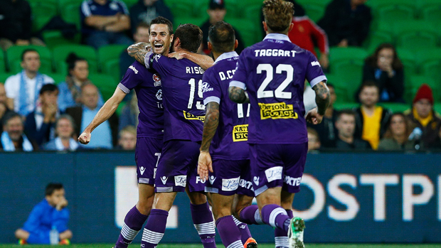 Perth Glory players celebrate Joel Chianese's goal in their 2-0 win over Melbourne City.