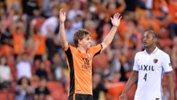 Brett Holman celebrates after his goal gave Roar a 2-0 lead over Kashima on Wednesday night.