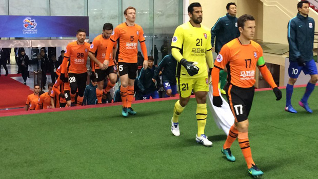 Brisbane Roar stunned Shanghai Shenhua 2-0 in China to qualify the ACL Group Stage.