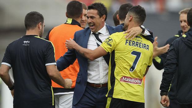 Paul Okon celebrates with Fabio Ferreira following the Mariners' win over Western Sydney.