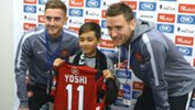Yoshi is presented with a Wanderers shirt on his visit to Western Sydney.
