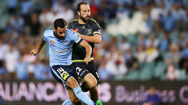 Phoenix skipper Andrew Durante challenges for the ball with Sydney FC striker Alex Brosque.