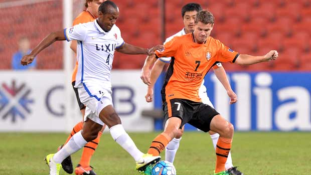 Roar's Thomas Kristensen and Kashima defender Leo Silva battle for possession in the ACL clash in Brisbane.