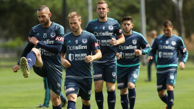 Carl Valeri leads Melbourne Victory's squad on the training ground.