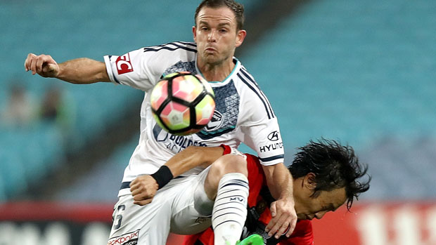 Victory defender Leigh Broxham challenges for the ball with Wanderers' Jumpei Kusukami.