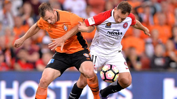 Brendon Santalab fights for the ball during Wanderers' loss to Brisbane Roar.