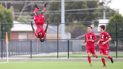 Pacifique Niyongabire celebrates with a trademark backflip after opening the scoring against Croydon kings on Saturday.