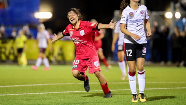 Alex Chidiac celebrates scoring in the Reds 10-2 romp of Western Sydney Wanderers.