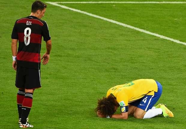Arsenal's Mesut Ozil apologised to David Luiz after Germany beat Brazil 7-1