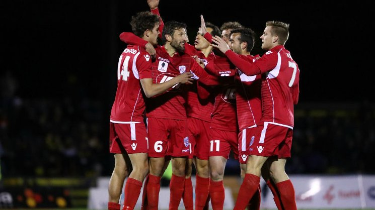 Adelaide United cruised into the semi finals with a 3-0 win over Heidelberg United.
