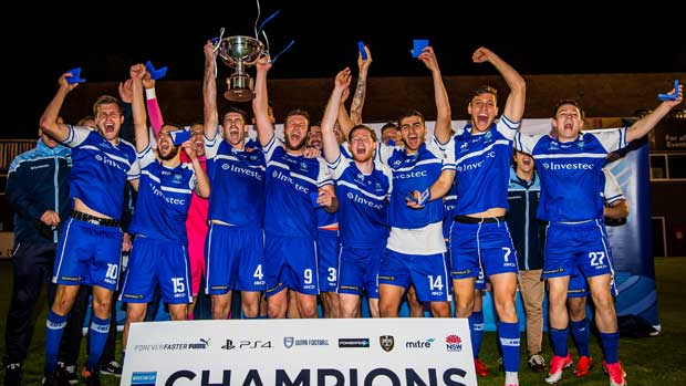 Hakoah players celebrate their Waratah Cup triumph against APIA Leichhardt on Sunday. Pic courtesy of Football NSW.