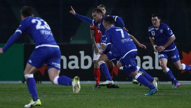 South Melbourne players celebrate Milos Lujic's late strike against Edgeworth FC.