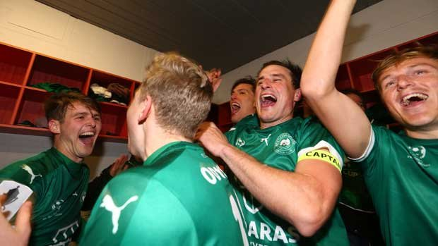 Bentleigh Greens players celebrate in the changerooms after their penalty-shootout win over Hume City.