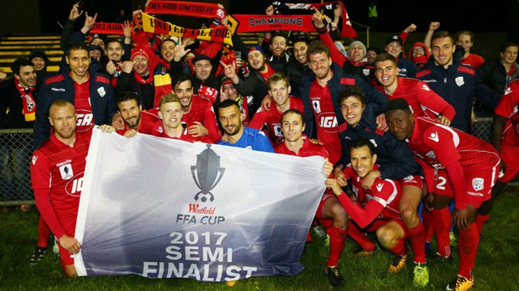 Adelaide United moved into the Westfield FFA Cup semi finals with a big win over Heidelberg United.